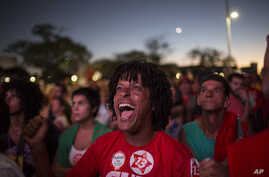 Brazil Political Crisis: Pro-government demonstrators react as they watch on a screen, as lawmakers vote on whether or not to impeach President Dilma Rousseff, in Brasilia, Brazil, Sunday, April 17, 2016.