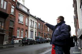 "A resident points at a house located in a street called ""Rue du Fort"" in Charleroi, Belgium, Jan. 13, 2016."