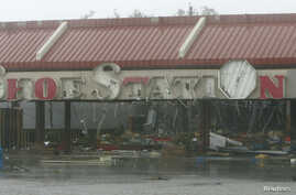 FILE - The Shoe Station, along with the majority of business in the Edgewater Village shopping Center, sustained extreme damage from Hurricane Katrina, Aug. 29, 2005.