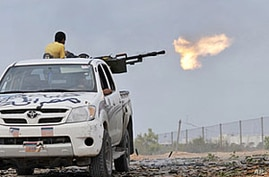 Libyan Provisional Forces Fight for Control of Gadhafi Hometown