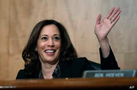 FILE - Sen. Kamala Harris, D-Calif., waves to another member of the committee during a hearing on Capitol Hil in Washington, Oct. 3, 2018.