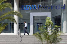 A man walks outside a branch of BBVA Provincial bank in Caracas, Venezuela, April 6, 2018.