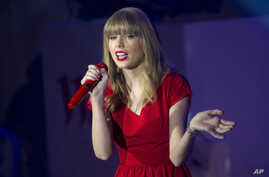 Taylor Swift performs songs from her newly released album 'Red' onstage at a shopping center after switching on the Christmas lights, London, Nov. 6, 2012.