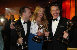 """Aaron Paul, winner for Outstanding Supporting Actor in a Drama Series, Anna Gunn, winner for Outstanding Supporting Actress in a Drama Series and Bryan Cranston, winner for Outstanding Lead Actor in a Drama Series, pose with their awards for AMC's  """""""