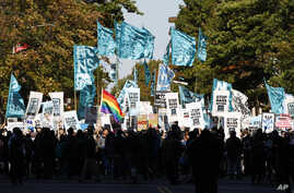 Demonstrators march through Washington toward the U.S. Capitol to rally and demand that the U.S. Congress investigate the National Security Agency's mass surveillance programs, Oct. 26, 2013.