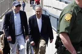 U.S. Senator John McCain, left, and Senator Charles Schumer tour the Nogales port of entry during their tour of the Mexico border with the United States on Wednesday, March 27, 2013, in Nogales, Arizona.