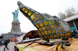 The original torch of the Statue of Liberty rests on a transporter, Nov. 15, 2018 in New York. The torch was being moved to a new museum on Liberty Island.
