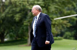 White House Deputy Chief of Staff for Operations Joe Hagin walks to the White House as he arrives on the South Lawn, Aug. 14, 2017, in Washington.