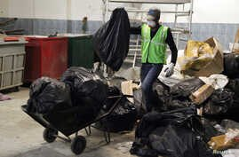 Workers from an environmentally-friendly rubbish disposal business called ScrapApp sort through garbage in a shopping mall in Noida, India, August 11, 2016.