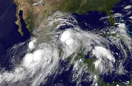 This image, provided by NOAA taken and Sunday Sept. 15, 2013 at 2:45 a.m. EDT shows Hurricane Ingrid in the Gulf of Mexico approaching the coast of Mexico and tropical storm Manuel just off the western coast of Mexico. Hurricane Ingrid was packing ma