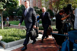 Kevin Downing, left, and Thomas Zehnle, the attorneys for Paul Manafort, arrive for the trial of former Trump campaign chairman Paul Manafort as it continues in federal court in Alexandria, Va., Tuesday, Aug. 7, 2018.