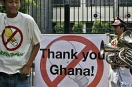 Activists of Greenpeace dance outside the Ghana embassy to congratulate the Ghana embassy staff on the 'banning of the light bulb' in Ghana, in New Delhi (File)