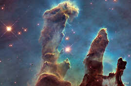 The Pillars of Creation, in the Eagle Nebula, one of the Hubble Telescope's most iconic images. (NASA, ESA, and the Hubble Heritage Team (STScI/AURA)
