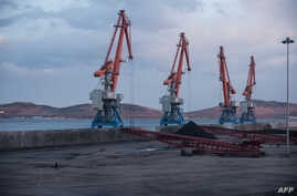 A photo taken on Nov. 21, 2017, shows cranes plus North Korean and Russian coal bound for China, at the RasonConTrans coal port at Rajin harbor in the Rason Special Economic Zone.