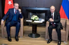 Russian President Vladimir Putin, right, talks with Turkish President Recep Tayyip Erdogan during their meeting in the Bocharov Ruchei residence in the Black Sea resort of Sochi, Russia, Nov. 13, 2017.