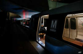A lone Metro rider sits on a train in L'Enfant Plaza Metro Station at the height of morning rush hour in Washington on March 5, 2015. (AP)