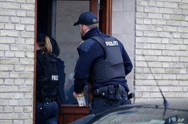 Danish police are seen entering an apartment as part of an operation that resulted in the arrest of four suspected Islamic State recruits, in Tingbjerg, Copenhagen, Denmark, Apr. 7, 2016.