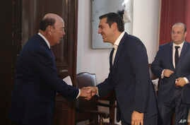 Greek Prime Minister Alexis Tsipras, center, welcomes U.S. Commerce Secretary Wilbur Ross, left, during their meeting in the northern port city of Thessaloniki , Greece, Sept 7, 2018.