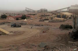 FILE - Diamond mine facilities are seen in the town of Oranjemund, Namibia, June 13, 2017.