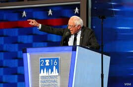 Bernie Sanders walked out to a thunderous, extended ovation as he took center-stage on the opening night of the Democratic National Convention in Philadelphia July 15, 2016 (A. Shaker/VOA)
