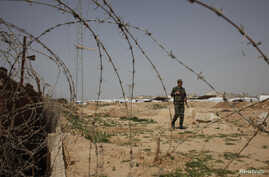 A member of Palestinian security forces loyal to Hamas patrols at the border between Egypt and the Gaza Strip, March 4, 2014.