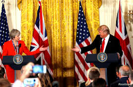 FILE - British Prime Minister Theresa May and U.S. President Donald Trump during their joint news conference at the White House in Washington, Jan. 27, 2017. Both the Trump presidential campaign and the Brexit campaign used Big Data to reach voters....