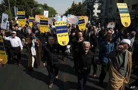 "Iranian protesters chant slogans in an anti-U.S. rally in Tehran, Iran, Sept. 22, 2017. The protesters condemned President Donald Trump's remarks at the United Nations, calling Iran a ""corrupt dictatorship"" and a ""murderous regime,"" and said the land"