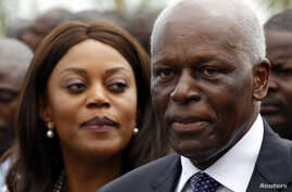 Angola's President Jose Eduardo dos Santos (R) and his wife Ana Paula attend the inauguration of the new Luanda Bay Marginal in the capital Luanda August 28, 2012.