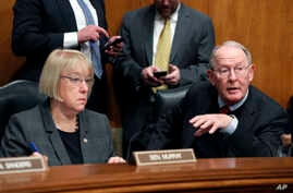 Sen. Lamar Alexander, R-Tenn., accompanied by Sen. Patty Murray, D-Wash. speaks on Capitol Hill in Washington, Jan. 31, 2017, during an executive session to discuss the nomination of Education Secretary-designate Betsy DeVos.  The two are getting to