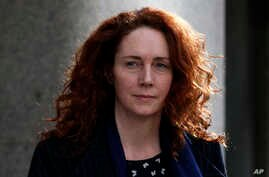 Rebekah Brooks, former News International chief executive leaves the Central Criminal Court in London where she appeared to face charges related to phone hacking, Feb. 19, 2014.