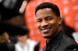 """Nate Parker, the director, star and producer of """"The Birth of a Nation,"""" poses at the premiere of the film at the 2016 Sundance Film Festival in Park City, Utah, Jan. 25, 2016."""