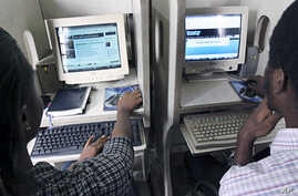 Nigerians browse the internet at a cybercafe in Lagos (File)