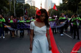 A woman takes part in a demonstration to commemorate the U.N. International Day for the Elimination of Violence against Women in Mexico City, Nov. 25, 2016.