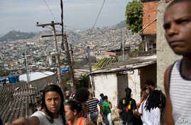 Residents gather in the Complexo da Penha slum in Rio de Janeiro, Brazil,  Aug. 22, 2018. Last year 523 workers were found in slavery-like conditions during labor inspections in Brazilian cities, about 225 more than in 2017 according to government da