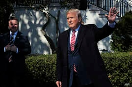 President Donald Trump waves as he leaves South Lawn of the White House, April 10, 2018.
