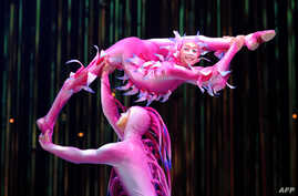 Cirque du Soleil performs onstage during Varekai at Carpa Santa in Mexico City, on September 18, 2013.