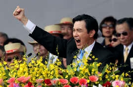 Taiwan's President Ma Ying-jeou cheers with the audience during National Day celebrations in front of the Presidential Office in Taipei, Taiwan, Oct. 10, 2013.