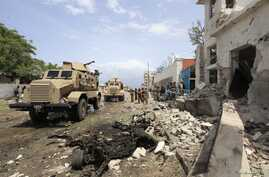 African Union Mission in Somalia (AMISOM) forces secure scene of suicide bombing outside the United Nations compound, Mogadishu, June 19, 2013.