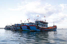 FILE - Fishing boats anchor near Ly Son island, in Vietnam's central Quang Ngai province.