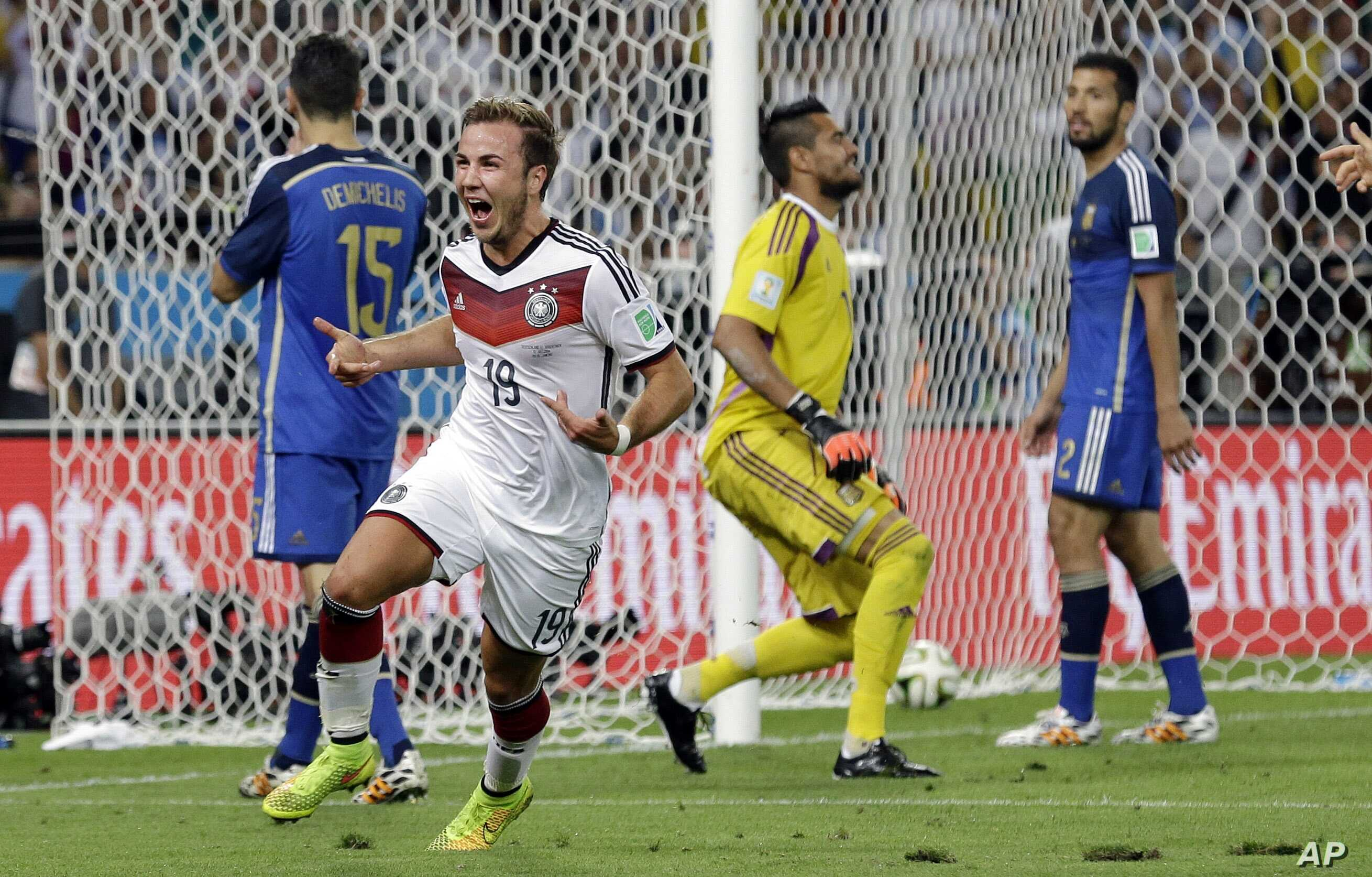 FILE - Germany's Mario Goetze celebrates after scoring on Argentina goalkeeper Sergio Romero during the World Cup final soccer match at the Maracana Stadium in Rio de Janeiro, Brazil, July 13, 2014.
