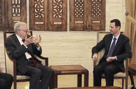 In this photo released by the Syrian official news agency SANA, Syrian President Bashar Assad, right, meets with the U.N.-Arab League envoy Lakhdar Brahimi, in Damascus, September 15, 2012.