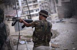 A Free Syrian Army fighter fires his weapon at Syrian Army positions in Aleppo, Syria, Tuesday, Sept. 11, 2012.