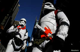 People dressed as Stormtroopers from Star Wars Rogue One walk in Times Square on Christmas Day in Manhattan, New York City, Dec. 25, 2016.