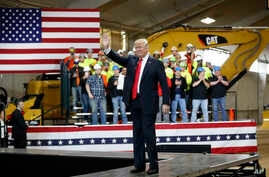 President Donald Trump waves as he is introduced to speak at Local 18 Richfield Training Facility, March 29, 2018, in Richfield, Ohio.