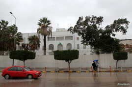 FILE - A car drives past the Italian embassy in Tripoli, Libya, Jan. 10, 2017.