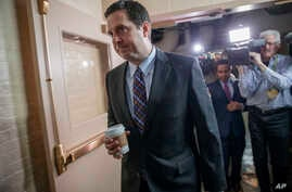 House Intelligence Committee Chairman Rep. Devin Nunes, R-Calif. is pursued by reporters as he arrives for a weekly meeting of the Republican Conference with House Speaker Paul Ryan and the GOP leadership, March 28, 2017, on Capitol Hill in Washingto...