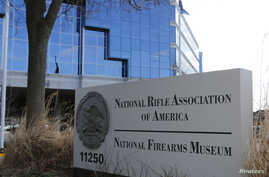 FILE - A sign of the National Rifle Association is seen in front of their headquarters in Fairfax, Virginia, March 14, 2013.