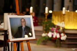A photo of Father Jacques Hamel is on display during his funeral mass at the Rouen cathedral, Normandy, France, Aug.2, 2016.