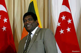 FILE PHOTO: Sri Lanka's foreign minister Ravi Karunanayake attends a bilateral meeting in Colombo, Sri Lanka, July 18, 2017.