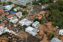 An aerial view shows collapsed houses following a landslide caused by Typhoon Wipha on Izu Oshima island, south of Tokyo, in this photo taken by Kyodo October 16, 2013. Four people were reported killed, schools closed, hundreds of flights cancelled a